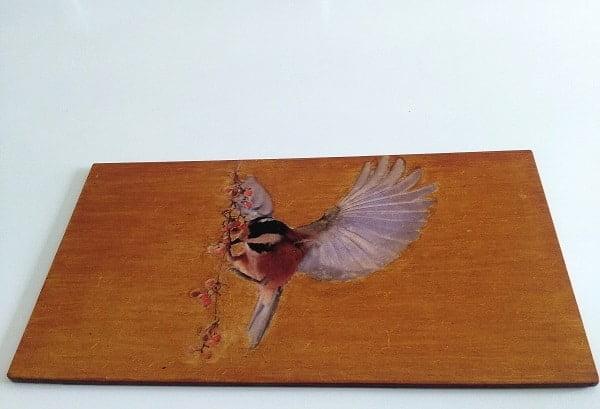 impression sur bois, illusion d un oiseau sur une branche
